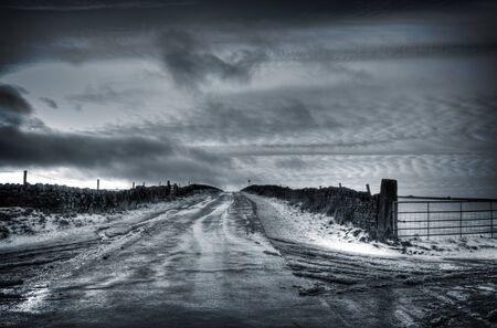 moorland: Moorland road in winter Stock Photo