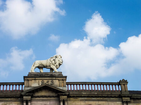Stone lion on Victorian building photo