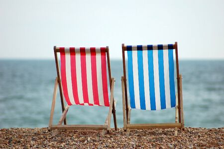 Two Deckchairs on the Beach in Brighton, England photo
