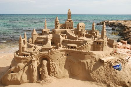 castle tower: Amazing sandcastle on a mediterranean beach
