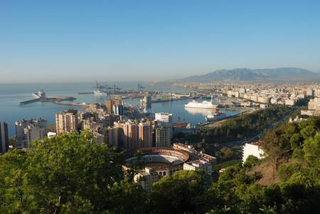 plaza de toros: View of Malaga, Spain with the Plaza de Toros in the foreground.  Stock Photo