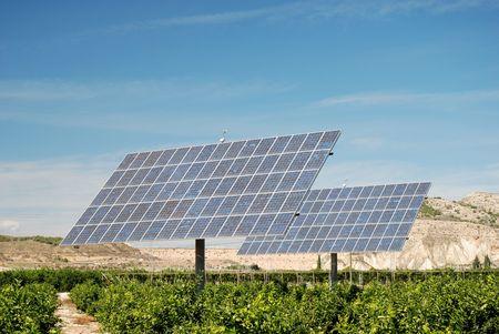 Solar panels on an orange plantation in Spain Stock Photo