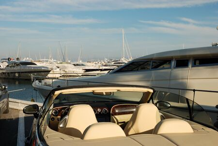 harbors: Luxury car and yachts in the harbor of Marbella, Spain