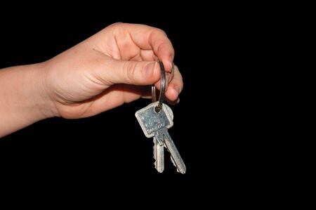 gestural: Handing over the keys, isolated on black