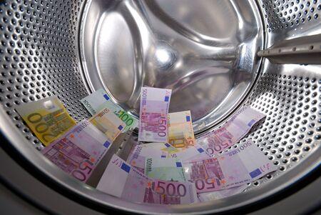 money laundering: Riciclaggio di denaro sporco nella lavatrice Archivio Fotografico