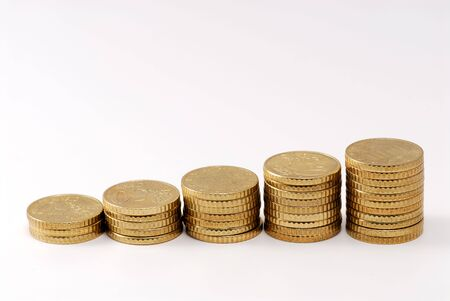 Euro coins piled up displaying a growing chart Stock Photo - 2689990