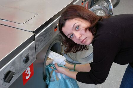 launderette: Young Woman doing the Laundry