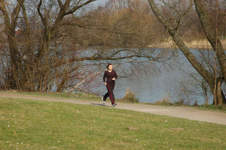 lesure: Girl Jogging Stock Photo