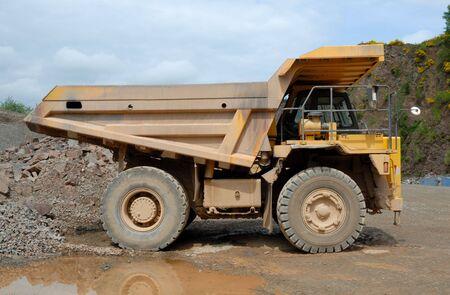 gravel pit: Big dumper truck in a stone pit Stock Photo