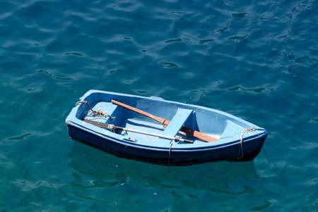 skiff: Rowboat in blue water, Santorini Greece