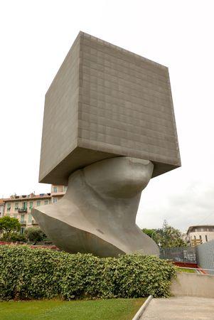 au: Tete au Carre (squared head), a sculpture in aluminium in the gardens of MAMAC, Nice, France Stock Photo