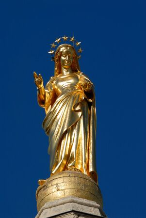 Gilded statue of the Virgin Mary at Avignon Cathedral, France photo