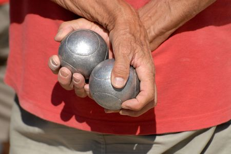 boules: French man holding the bowls