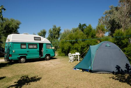 campsite: Small european motorhome parked at campsite in France