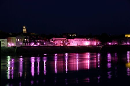rhone: Streetlights reflecting in river Rhone at Arles, southern France Stock Photo