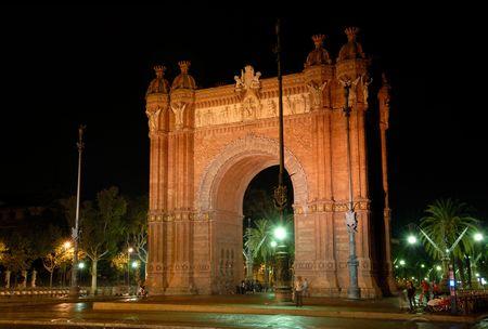 Triumphal arch (Arc de Triomf) at night, Barcelona, Spain photo