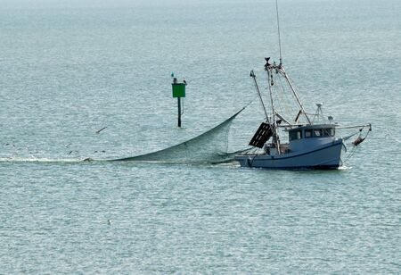 net fishing: Small fishing boat in the sea