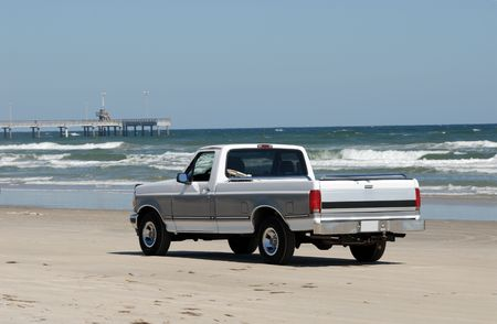 pickup: Pickup truck driving on the beach in the southern Texas, USA