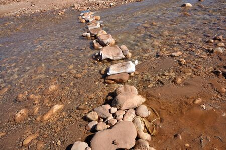 Stepping stones over the Ouarzazate River in Morocco photo