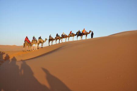 merzouga: Camel trip in Sahara desert Merzouga, Morocco, north Africa Stock Photo