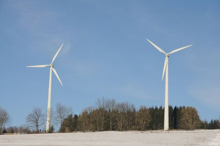 winterly: Two wind turbines in winterly landscape Stock Photo
