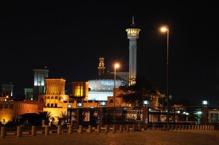 bur dubai: Mosque in Bur Dubai illuminated at night Stock Photo