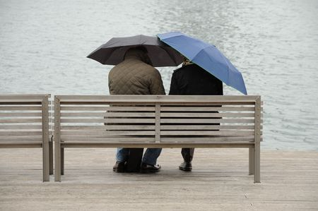 rainy day: Couple with umbrellas in Barcelona, Spain Stock Photo
