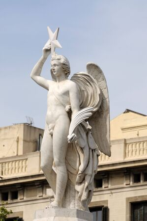 male angel: Statue in Barcelona Spain