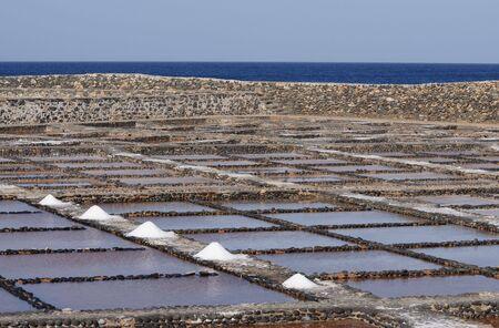 saltmine: Salt evaporation ponds near Caleta de Fuste on Canary Island Fuerteventura, Spain Stock Photo
