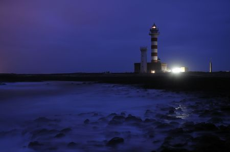 Lighthouse Faro el Toston at night. Canary Island Fuerteventura Spain photo