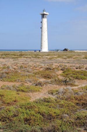 salt marsh: Salt marsh and lighthouse in Jandia Playa, Fuerteventura