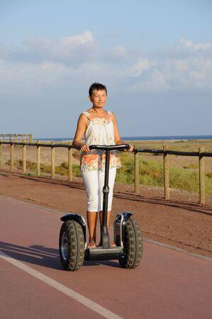 oap: Pensioner woman driving segway