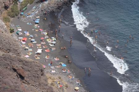 nudist: Black volcanic beach Playa de Las Gaviotas. Canary Island Tenerife, Spain