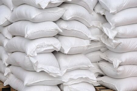 stacked: Stacked white sacks at storehouse