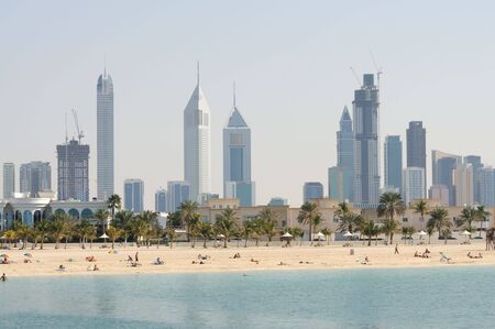 Dubai City Skyline, Jumeirah Beach Park in Foreground. United Arab Emirates