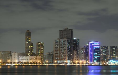 sharjah: Sharjah City Skyline at dusk, United Arab Emirates Stock Photo