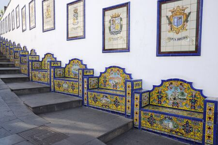 grand canary: Colorful benches in town Firgas, Grand Canary Spain Stock Photo
