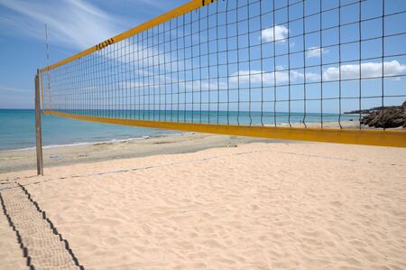 Volleyball net on the beach photo