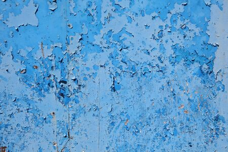 Old grungy blue paint on wooden surface photo