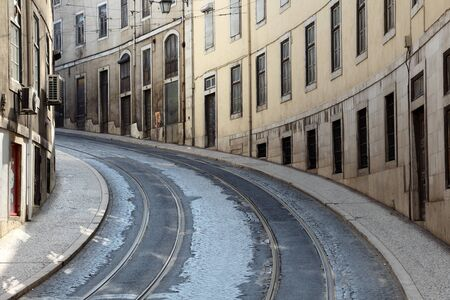 Street with tramway rails in Lisbon, Portugal photo