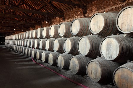 Old wine cellar full of wooden barrels photo