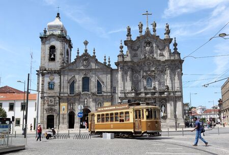 Old trolley car in front of a church in Porto, Portugal. Photo taken at 03 July 2010
