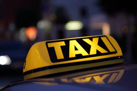 taxis: Taxi sign at night Stock Photo