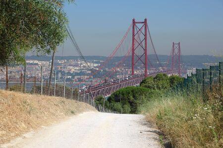 Ponte 25 de Abril - Suspension bridge over the Tagus river in Lisbon, Portugal photo