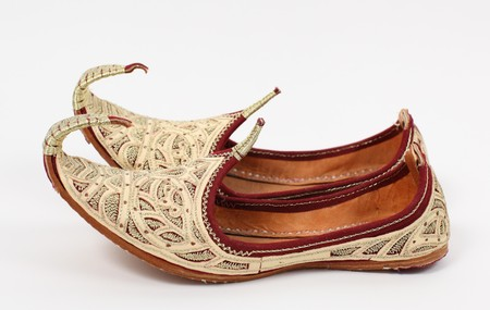 aladdin: Traditional Arabic shoes over white background Stock Photo