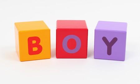 Word BOY wrtitten with wooden letter blocks Stock Photo - 7671454