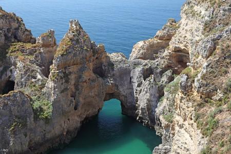 Cliffs at the coast of Algarve, Portugal photo
