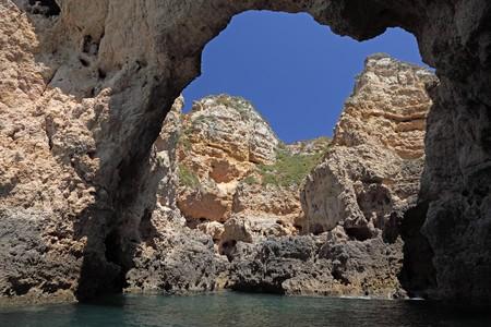 Rocks at the Algarve coast in Portugal photo