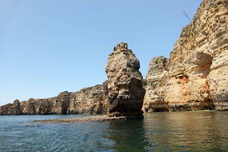 Rocky Algarve coast in Portugal photo