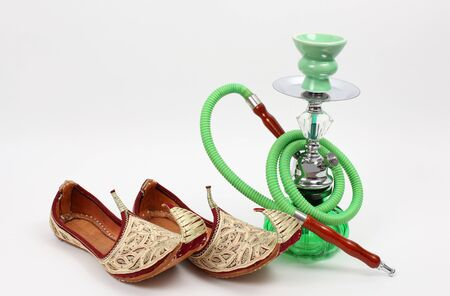waterpipe: Water pipe and traditional Arabic shoes Stock Photo